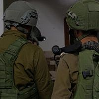 Israeli troops measure the homes of two Palestinians suspected of killing Dvir Sorek for demolition in the southern West Bank on August 12, 2019. (Israel Defense Forces)