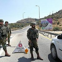 Israeli soldiers set up a roadblock as part of a search effort to find terrorists who set off a bomb near the Israeli settlement of Dolev in the West Bank on August 23, 2019, killing an Israeli teenage girl and seriously injuring two other people. (Israel Defense Forces)