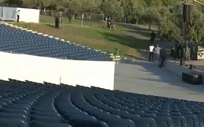 The auditorium in Afula divided by a white partition ahead of the planned concert on August 14, 2019 (Screencapture/Channel 12)