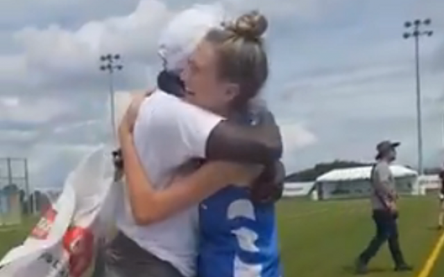 Israel and Kenyan lacrosse players embrace after the Israeli team gifts its opponents with new cleated shoes, August 7, 2019 (video screenshot)
