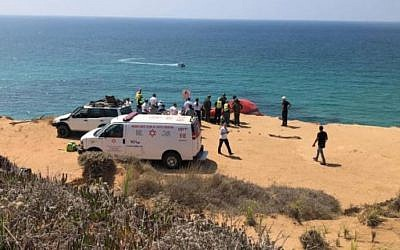 Rescuers at the scene of a paraglider crash the killed one person and wounded another, atop a seaside cliff near Herzliya, August 28, 2019. (Magen David Adom)