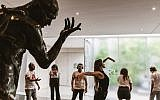 Actress Rona Lee Shim'on demonstrates to her audience how to move with a Rodin sculpture, in 'Moved by Art,' a new program at the Israel Museum (Courtesy Barak Aharon)