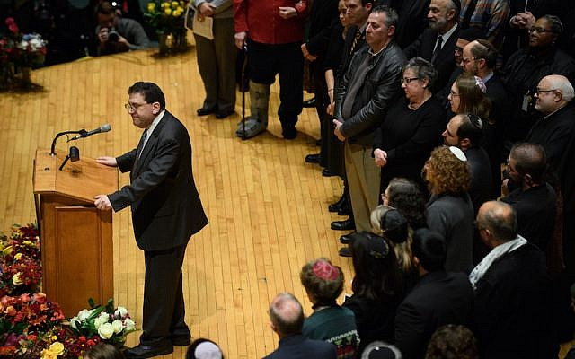 Rabbi Jonathan Perlman speaks to thousands at the Soldiers and Sailors Memorial Hall during a service to honor and mourn the victims of the mass shooting at the Tree Of Life Synagogue, in Pittsburgh on October 28, 2018. (Jeff Swensen/Getty Images via JTA)