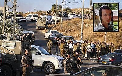 Israeli security forces at the scene where the body of an off-duty, out-of-uniform Israeli soldier Dvir Sorek, upper-right, was found dead with stab wounds, near the settlement of Migdal Oz in the Etzion region, on August 8, 2019. (Gershon Elinson/Flash90)