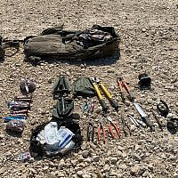 This photo released by the IDF shows a collection on weapons, including rifles, RPG launchers, grenades, bold cutters and knives carried by four Gazans who tried to cross the border into Israel, August 10, 2019. (Israel Defense Forces)