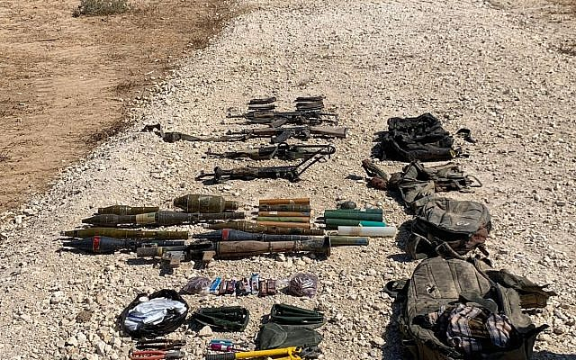 This photo released by the IDF shows a collection on weapons, including rifles, RPG launchers, grenades, bold cutters, and knives carried by four Gazans who tried to cross the border into Israel, August 10, 2019. (Israel Defense Forces)