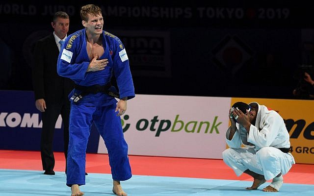 Belgium's Matthias Casse (in blue) celebrates winning the semifinal fight against Iran's Saeid Mollaei in the men's under-81 kilogram category during the 2019 Judo World Championships in Tokyo on August 28, 2019. (Charly Triballeau/AFP)