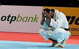 Iran's judoka Saeid Mollaei reacts after losing to Belgium's Matthias Casse in the semifinal fight in the men's under-81 kilogram category during the 2019 Judo World Championships in Tokyo on August 28, 2019. (Charly Triballeau/AFP)