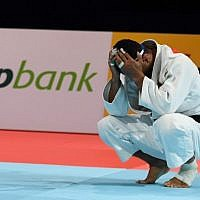 Iran's judoka Saeid Mollaei reacts after losing to Belgium's Matthias Casse in the semi-final fight in the men's under-81 kilogram category during the 2019 Judo World Championships in Tokyo on August 28, 2019. (Charly Triballeau/AFP)