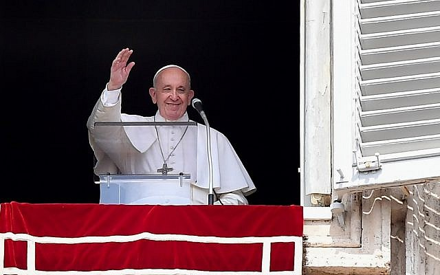 Pope Francis waves from the window of the apostolic palace overlooking St. Peter's square during the weekly Angelus prayer on September 1, 2019 at the Vatican. (Photo by Tiziana FABI / AFP)