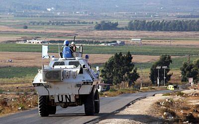 Vehicles belonging to UN peacekeepers drive along a road along the Israel-Lebanon border near the southern Lebanese town of Kfar Kila on September 1, 2019. (Ali Dia/AFP)