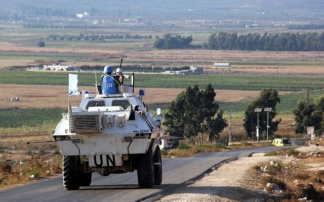 Vehicles belonging to UN peacekeepers drive along a road along the Israel-Lebanon border near the southern Lebanese town of Kfar Kila on September 1, 2019. (Ali Dia/AFP)
