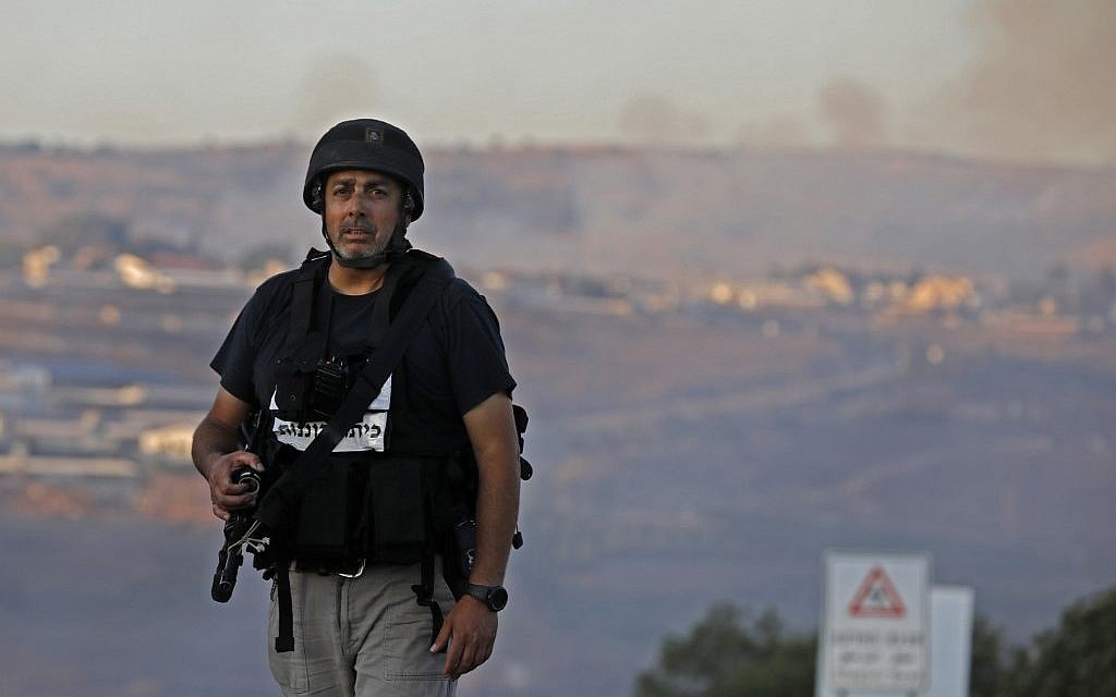 A member of the Israeli security forces stands at a security checkpoint near the northern Israeli town of Avivim, close to the border with Lebanon, on September 1, 2019. (Jalaa MAREY / AFP)