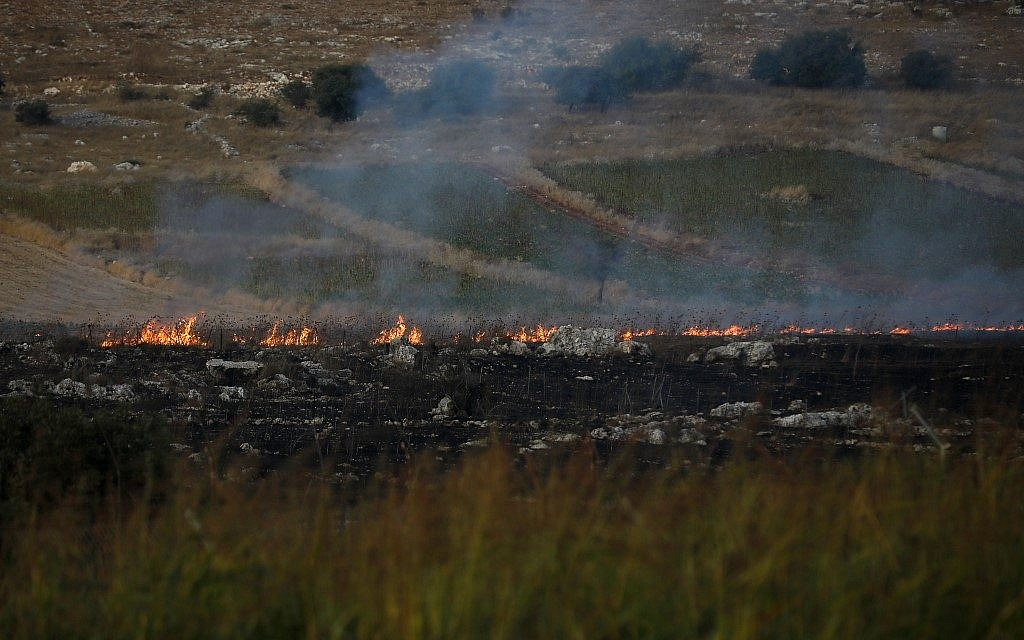 This picture taken on September 1, 2019 from a location near the northern Israeli town of Avivim, close to the border with Lebanon, shows fires and smoke rising after Lebanon's Shiite Hezbollah terror movement fired anti-tank missiles into northern Israel (Jalaa MAREY / AFP)