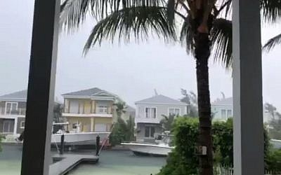 This video grab image shows boats are tied up in preparation for the approach of Hurricane Dorian on September 1, 2019 in Sandyport, Nassau, Bahamas. (Lucy Worboys/AFP)