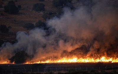 This picture taken on September 1, 2019, from a location near the northern Israeli town of Avivim, shows a fire blazing in a field along the border with Israel on the Lebanese side following an exchange of fire. (ALAA MAREY / AFP)