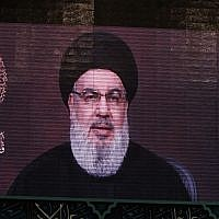 A speech by Hassan Nasrallah, the head of the Hezbollah terror group, is transmitted on a large screen in the Lebanese capital Beirut's southern suburbs on September 2, 2019. (AFP)