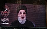 A speech by the Lebanese Shiite Hezbollah terror group's leader Hassan Nasrallah is transmitted on a large screen in the Lebanese capital Beirut's southern suburbs on September 2, 2019. (AFP)