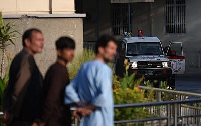 An ambulance is pictured outside Wazir Akbar Khan hospital as people wait after a massive explosion the night before in Kabul on September 3, 2019. (WAKIL KOHSAR / AFP)