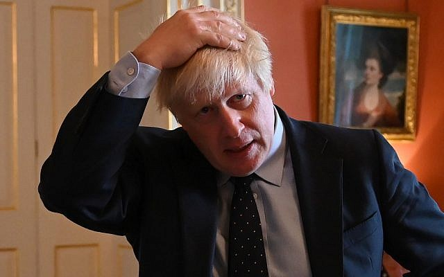 Britain's Prime Minister Boris Johnson reacts as he greets NHS workers as they take afternoon tea inside 10 Downing Street in central London on September 3, 2019. (Photo by DANIEL LEAL-OLIVAS / various sources / AFP)