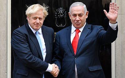 Britain's Prime Minister Boris Johnson (L) greets Prime Minister Benjamin Netanyahu outside 10 Downing Street in central London on September 5, 2019. (DANIEL LEAL-OLIVAS / AFP)