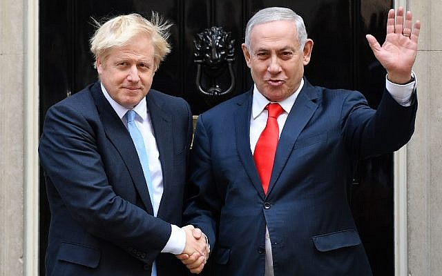 Britain's Prime Minister Boris Johnson (L) greets Prime Minister Benjamin Netanyahu outside 10 Downing Street in central London on September 5, 2019. (DANIEL LEAL-OLIVAS / AFP)
