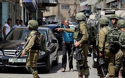Israeli security forces conduct a search operation following a reported stabbing attack in the West Bank village of Azzun near Qalqilya on September 7, 2019. (Jaafar ASHTIYEH / AFP)