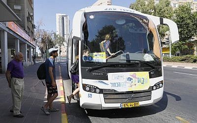 People board the 'sababus,' a bus service that works on Shabbat, or Saturday, a day of religious observance and abstinence from work, kept by Jews from Friday evening to Saturday evening, on September 7, 2019 in Ramat Gan (JACK GUEZ / AFP)