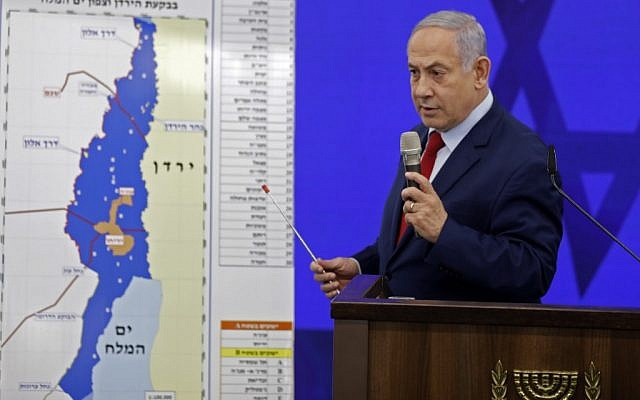 Prime Minister Benjamin Netanyahu speaks before a map of the Jordan Valley, vowing to extend Israeli sovereignty there if reelected, during a speech in Ramat Gan on September 10, 2019. (Menahem Kahana/AFP)