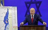 Prime Minister Benjamin Netanyahu speaks before a map of the Jordan Valley as he gives a statement, promising to extend Israeli sovereignty to the Jordan Valley and northern Dead Sea area, in Ramat Gan on September 10, 2019. (Menahem KAHANA / AFP)