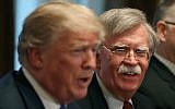 In this file photo taken on April 9, 2018 former National Security Adviser John Bolton (R), listens to US President Donald Trump. (MARK WILSON / GETTY IMAGES NORTH AMERICA / AFP)