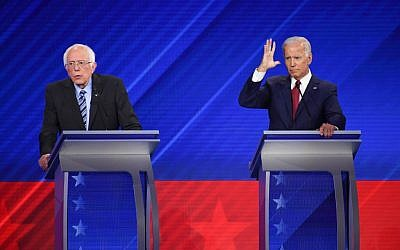 Democratic presidential hopefuls Vermont Senator Bernie Sanders (L) and former vice president Joe Biden (R) speak during the third Democratic primary debate of the 2020 presidential campaign season hosted by ABC News in partnership with Univision at Texas Southern University in Houston, Texas on September 12, 2019. (Robyn Beck/AFP)
