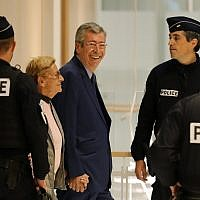 Mayor of Levallois-Perret Patrick Balkany (C,R) and his wife first deputy mayor Isabelle Balkany prosecuted with alleged aggravated tax fraud arrive on September 13, 2019 for the rendering of the verdict at the Paris courthouse. (Thomas SAMSON / AFP)