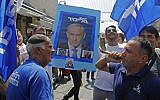 Supporters of Prime Minister Benjamin Netanyahu march at the Mahane Yehuda Market in Jerusalem on September 13, 2019. (MENAHEM KAHANA / AFP)