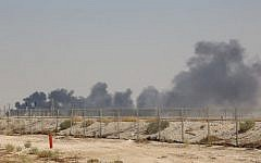 Smoke billows from an Aramco oil facility in Abqaiq about 60km (37 miles) southwest of Dhahran in Saudi Arabia's eastern province on September 14, 2019. (AFP)