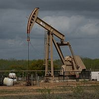 In this file photo taken on March 12, 2019 a pump jack at an oil extraction site is pictured in Cotulla, Texas (Loren ELLIOTT / AFP)