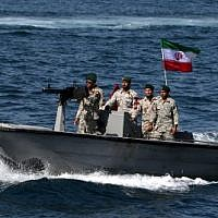 In this file photo taken on April 30, 2019, Iranian military personnel ride in a patrol boat as they take part in the 'National Persian Gulf Day' in the Strait of Hormuz (Photo by ATTA KENARE / AFP)