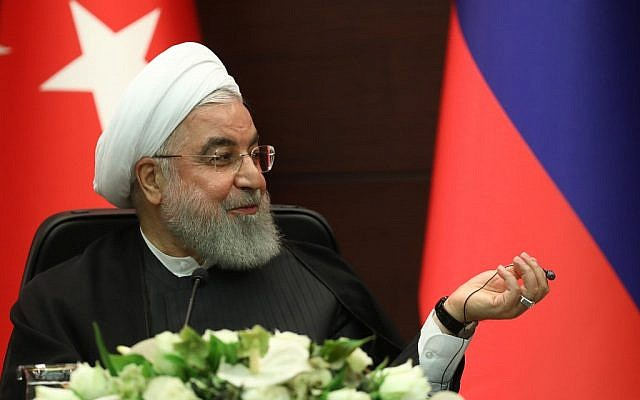 Iranian President Hassan Rouhani speaks during a joint press conference with Turkish and Russian counterparts following a trilateral meeting on Syria, in Ankara on September 16, 2019. (Adem Altan/AFP)
