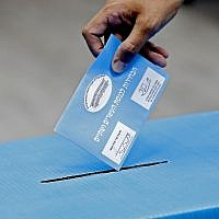 An Israeli man casts his ballot during Israel's parliamentary election, at a polling station in Rosh Haayin, on September 17, 2019. (Jack GUEZ/AFP)