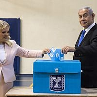 Prime Minister Benjamin Netanyahu and his wife Sara casts their votes at a voting station in Jerusalem on September 17, 2019. (Heidi Levine/AFP)
