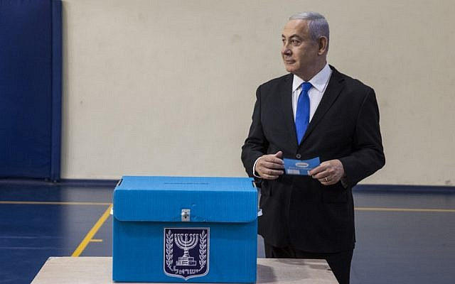 Prime Minister Benjamin Netanyahu casts his vote at a voting station in Jerusalem on September 17, 2019. (Heidi Levine/AFP)