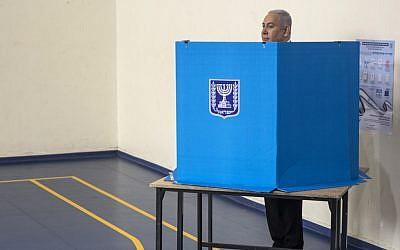 Prime Minister Benjamin Netanyahu casts his vote at a voting station in Jerusalem on September 17, 2019. (Heidi Levine/AFP)