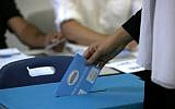 A member of the Israeli Druze community casts her ballot during Israel's parliamentary elections on September 17, 2019, in Daliyat al-Karmel in northern Israel. (Jalaa Marey/AFP)