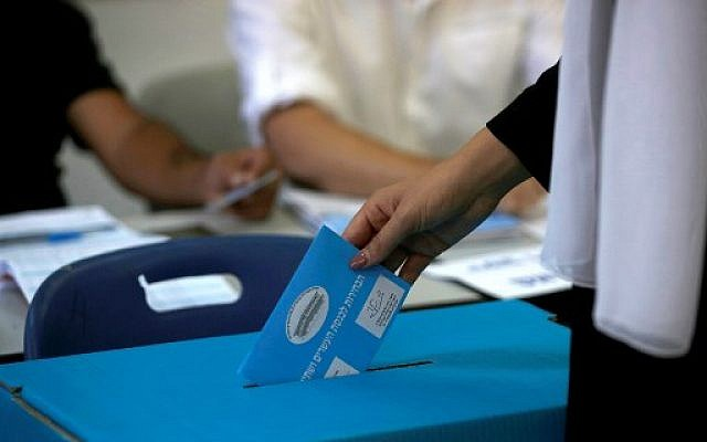 A member of the Israeli Druze community casts her ballot during Israel's parliamentary elections on September 17, 2019, in Daliyat al-karmel in northern Israel. (Photo by JALAA MAREY / AFP)