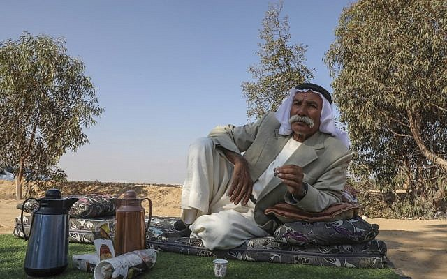 Sheikh Sayiah al-Turi, the head of an unauthorized Bedouin village in the Negev, drinks a cup of coffee in al-Araqib village near the southern city of Beersheva after voting in the parliamentary elections on September 17, 2019.  (HAZEM BADER / AFP)