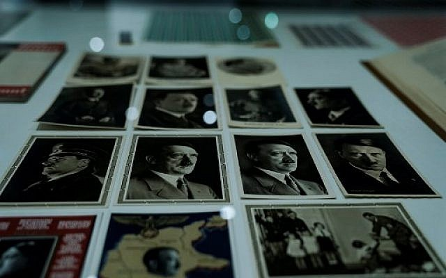 "Adolf Hitler's postcards are displayed during the exhibition ""Design of the Third Reich""  at the Design Museum Den Bosch in 's-Hertogenbosch, Netherlands, on September 17, 2019. (Photo by Kenzo TRIBOUILLARD / AFP)"