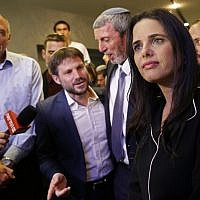 Ayelet Shaked (R), leader and candidate of the New Right party that is part of the Yamina political alliance, speaks to the press while flanked by Jewish Home member and candidate Moti Yogev (L), National Union party leader and candidate Bezalel Smotrich (2nd-L), (Gil Cohen-Magen/AFP)