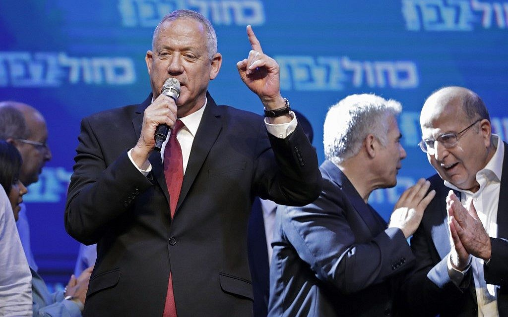 Blue and White head Benny Gantz addresses supporters at the alliance's campaign headquarters in the Israeli coastal city of Tel Aviv early on September 18, 2019, as his allies Yair Lapid (2nd-R) of the Yesh Atid party and Moshe Yaalon (R) of the Telem party speak behind. (EMMANUEL DUNAND / AFP)