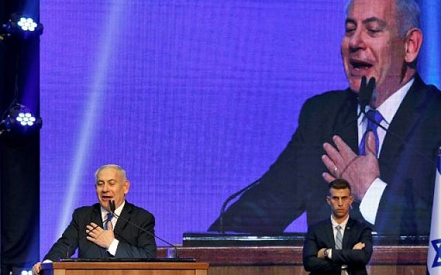 Israeli Prime Minister Benjamin Netanyahu addresses supporters at his Likud party's electoral campaign headquarters early on September 18, 2019.(MENAHEM KAHANA / AFP)
