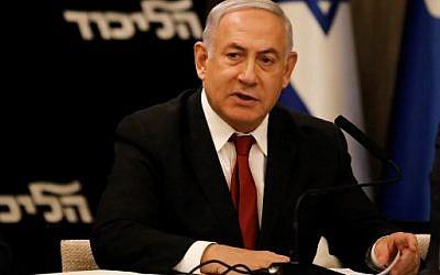 Prime Minister Benjamin Netanyahu speaks during his Likud party meeting in Jerusalem on September 18, 2019.  (Photo by MENAHEM KAHANA / AFP)